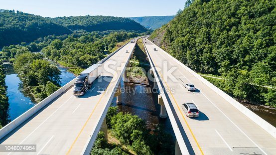 The aerial scenic view of the elevated highway on the high bridge over the Lehigh River at the Pennsylvania Turnpike. Lehigh Valley, Poconos region, Pennsylvania, USA.