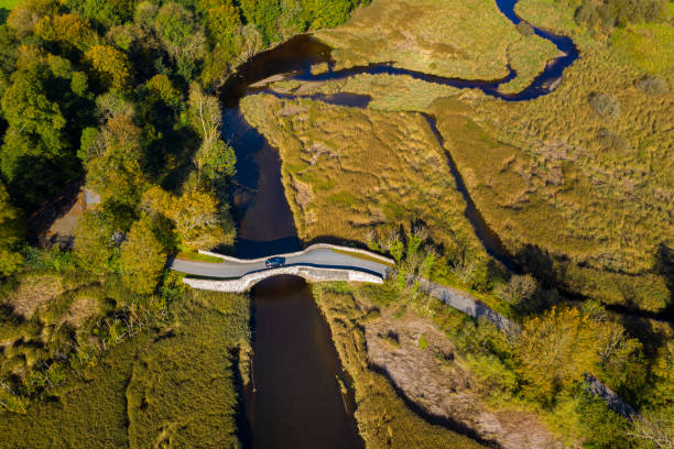 The aerial view from a drone of an old stone bridge in Dumfries and Galloway south west Scotland The view from a drone of an old stone bridge crossing a small river that flows into an estuary in Dumfries and Galloway, south west Scotland. johnfscott stock pictures, royalty-free photos & images