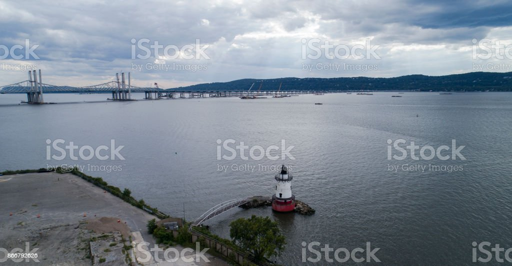 The aerial view ot the Sleepy Hollow Lighthouse on the Hudson River, in front of the Tappan Zee Bridge stock photo