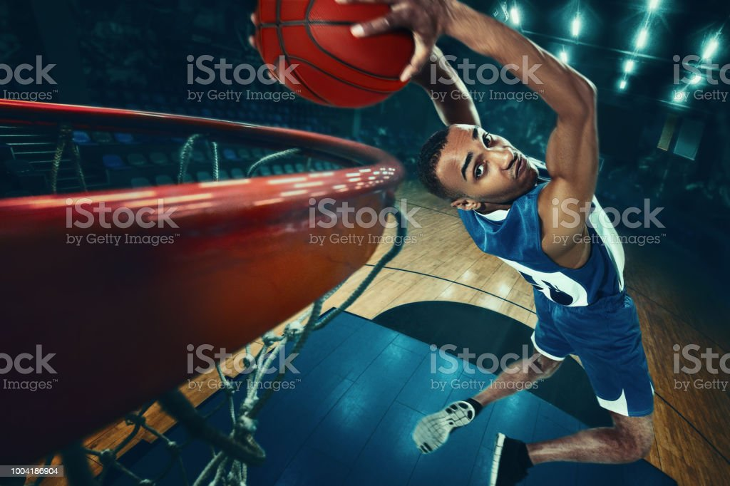 The african man basketball player jumping with ball stock photo