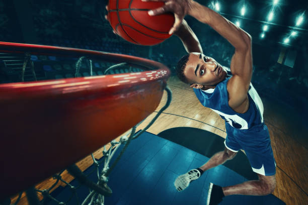 the african man basketball player jumping with ball - basketball stock pictures, royalty-free photos & images