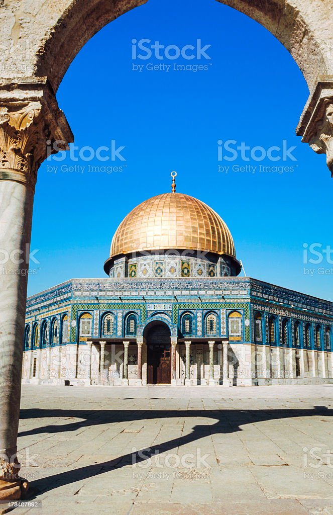 The afternoon sun shines on the golden Dome stock photo