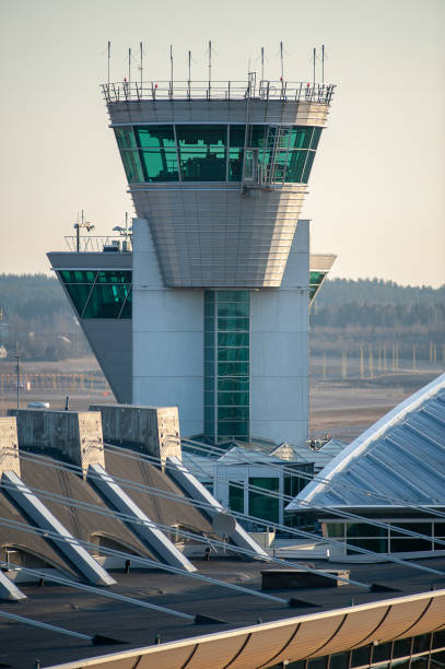 The air traffic control tower in Helsinki-Vantaa Airport operated by Finavia handles more than 600 airside operations daily. The airport is the main hub for the Finnish flag carrier Finnair. stock photo