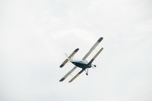 istock The aircraft in the cloudy sky. 1129620577