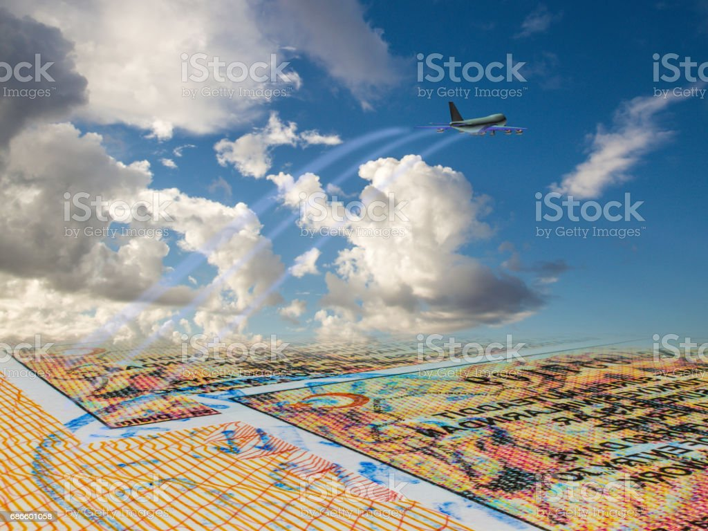 The airliner rises from the page of the foreign passport, the concept of travel, air travel stock photo