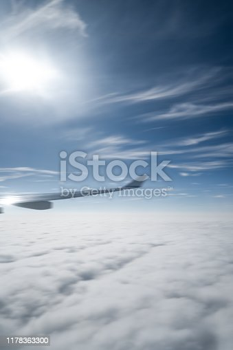 The airplane flew over the clouds.