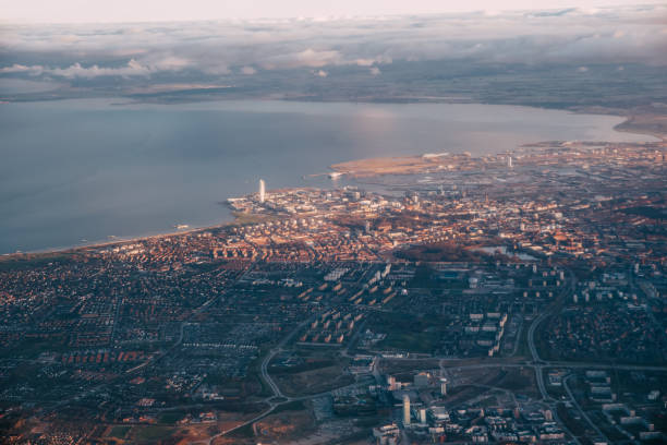 The airplane flying over Gdansk. stock photo