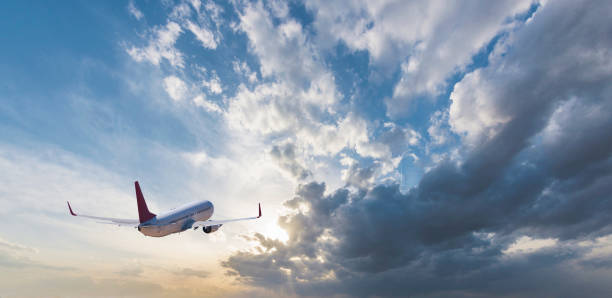 The airplane is flying towards the sky beautifully stock photo