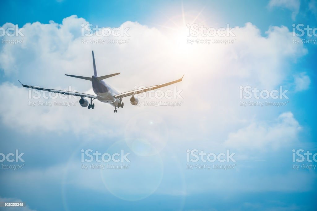 The airplane is flying towards the sky beautifully. stock photo