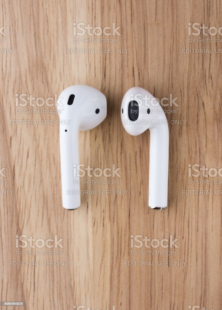The Airpods Headset Lies On A Wooden Table Wireless Headphones
