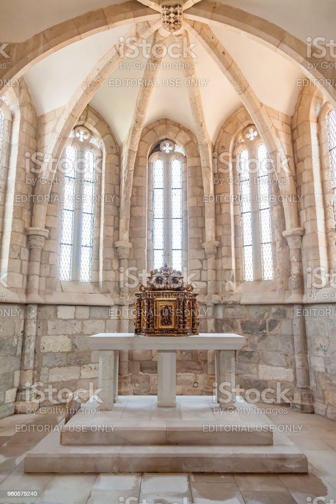 The aisle, altar and a gilded baroque tabernacle in the medieval church of Santa Cruz. stock photo
