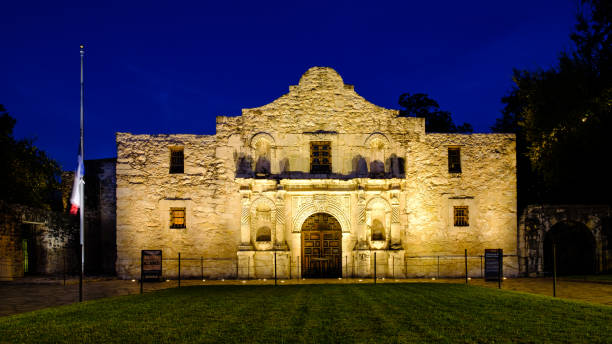 the alamo at dusk - the alamo stock photos and pictures