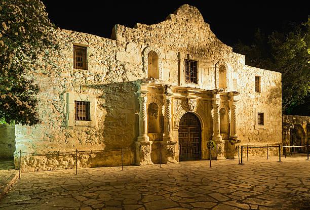 the alamo  san antonio texas, in golden incandescent nighttime light - the alamo stock photos and pictures