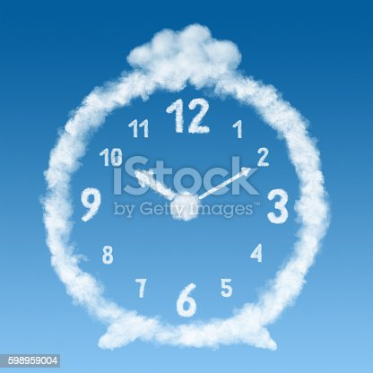 istock the alarm clock made of clouds in blue sky 598959004