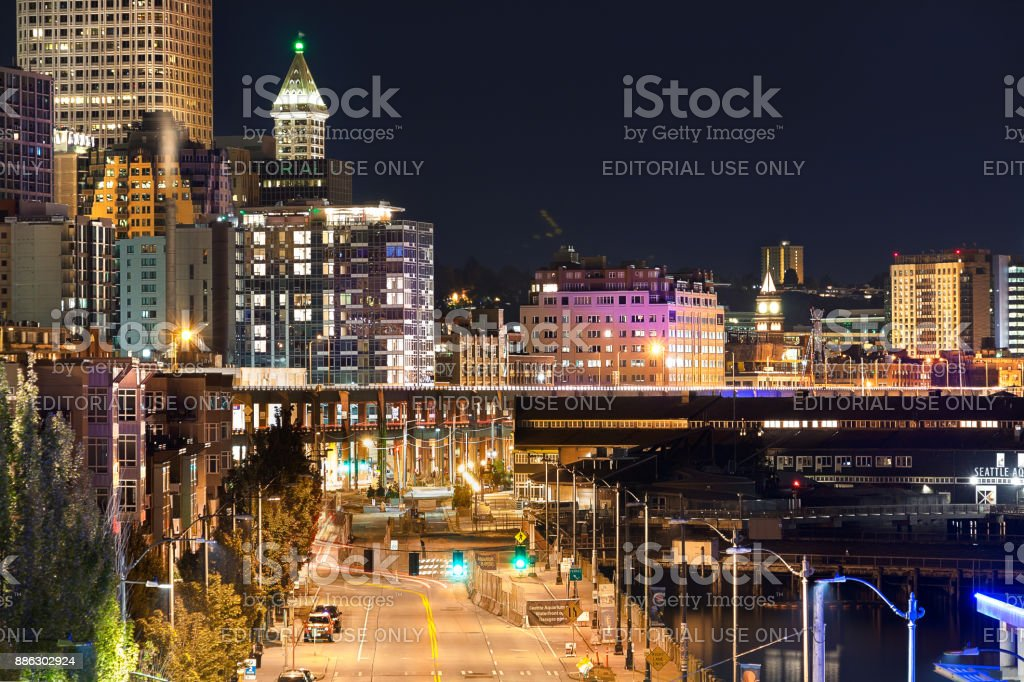 The Alaskan way at night in Seattle, Washington. stock photo
