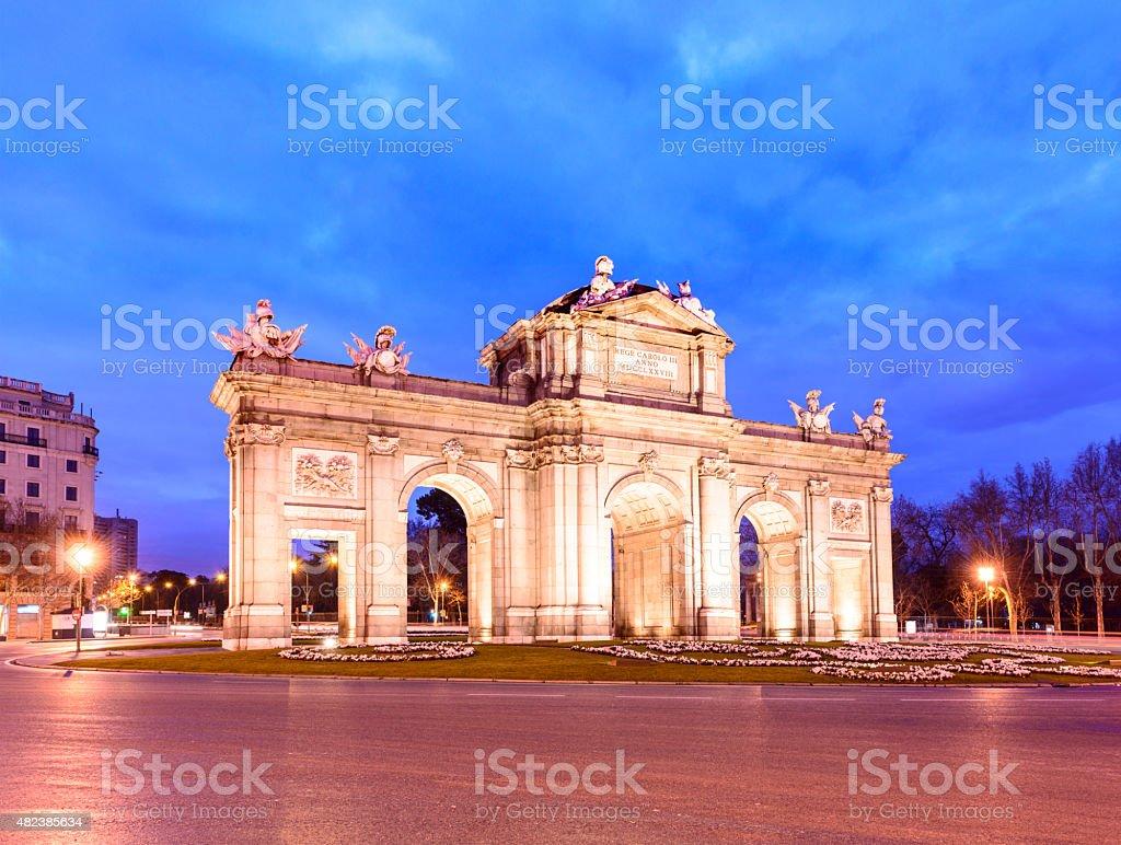 The Alcala Gate Illuminated at Twilight in Madrid Spain stock photo