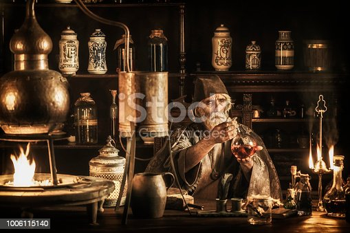 Medieval alchemist in his laboratory