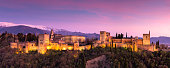 Granada, Andalucia, Spain - 29th March 2015: Panoramic view of The Alhambra Palace at dusk in Granada, Andalucia, Spain