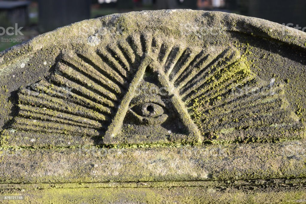 The All Seeing Eye engraved on a tombstone stock photo