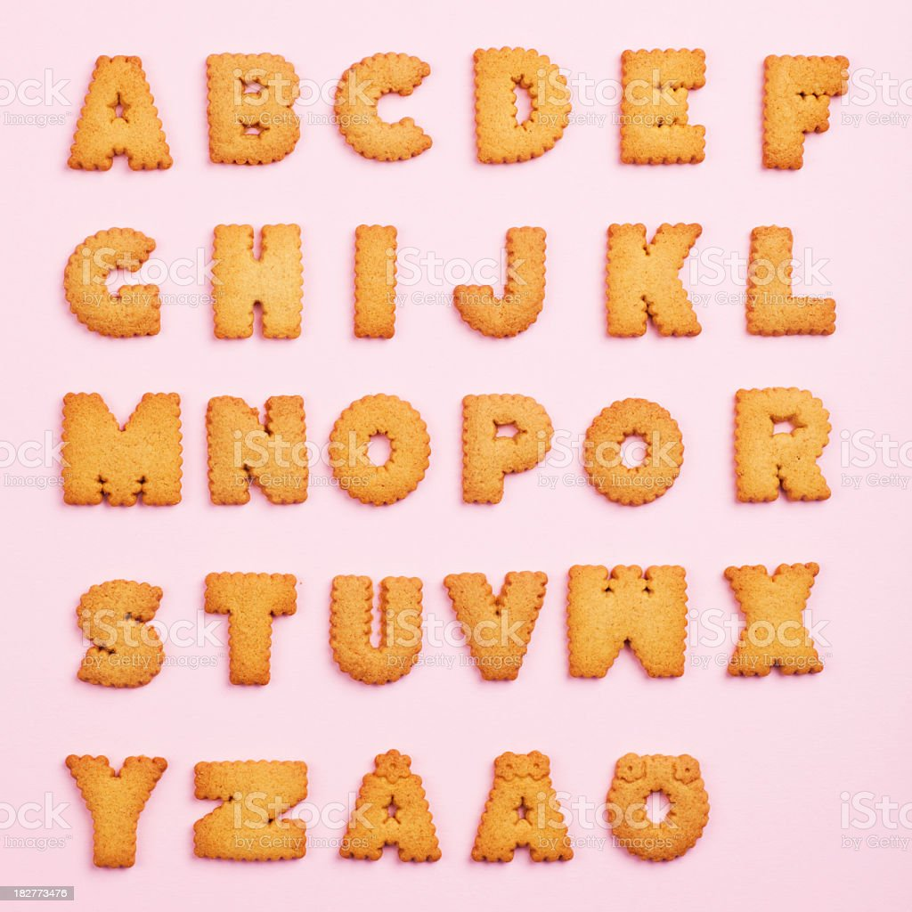 The Alphabet made of cookies on a pink background stock photo