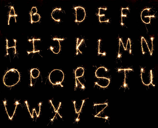 the alphabet painted with sparklers - ruth 個照片及圖片檔