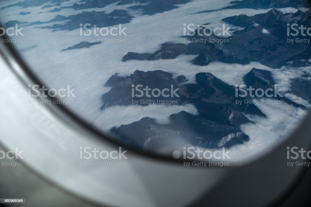 The alps coverd in clouds stock photo