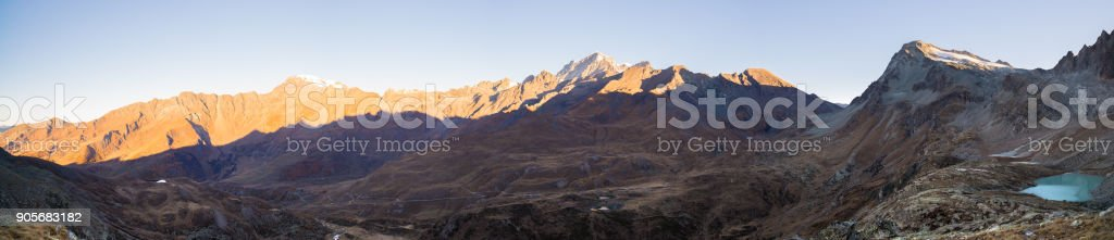 The Alps in Italy at sunset, famous travel destination in summertime. Ultra wide panoramic view stock photo