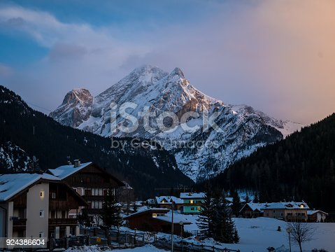 istock The alps town of Canazei in Italy. Houses in foreground and big mountain in background. Winter and morning or evening light. 924386604