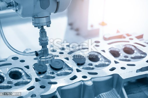 936360074 istock photo The aluminium casting cylinder head parts in the assembly process with the exhaust and intake valve parts in the light blue scene. 1175266113