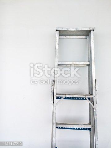 1048837520 istock photo The aluminum foldable ladder. 1154417212