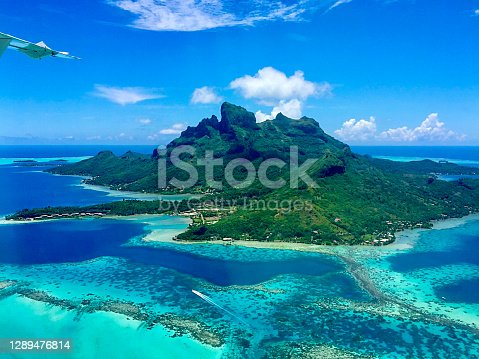 When flying away from Bora Bora island, the Aerial View of the Paradise Bora Bora Island is truly amazing. Here is  Bora Bora Island, the atoll, the lagoon, the resorts and Mt. Otemanu seen from the air.