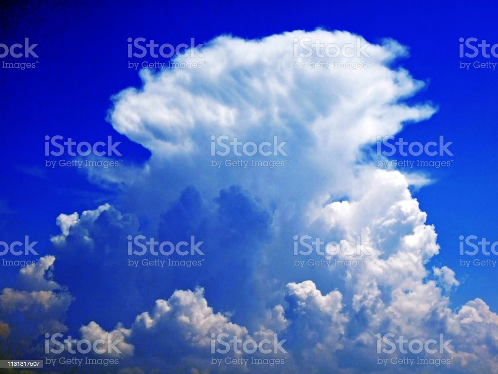 The amazing clouds over the Alps mountain range over the river Rhein...