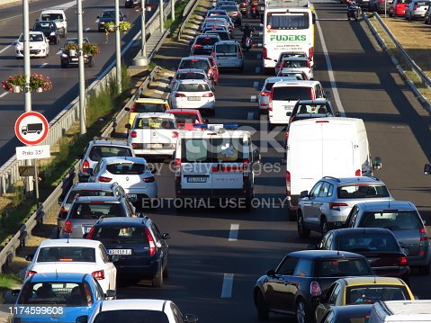 Belgrade, Serbia, September 13, 2019. The ambulance car breaks through the traffic jam in rush hour on highway E-75.