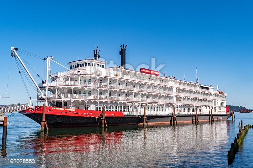 Astoria, Oregon - October 03 2017: The American Empress, formerly Empress of the North, a 360 foot diesel powered paddle-wheeler river cruise ship/ riverboat, docked on the Columbus River in Astoria.