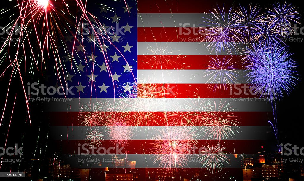 The American flag and fireworks in the independence day stock photo