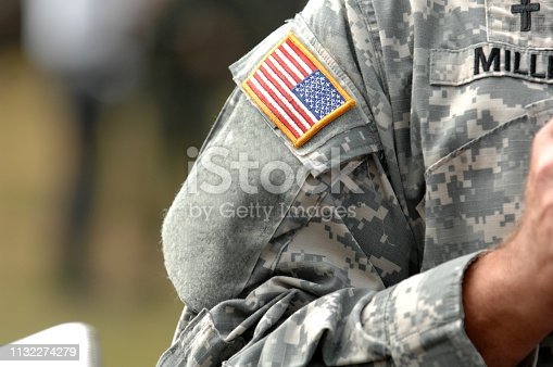 the American flag attached to the American military uniform.