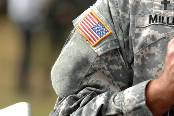 the american flag attached to the american military uniform. - tropa imagens e fotografias de stock