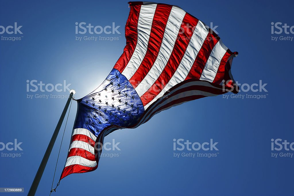 The American Flag backlit  from sun stock photo