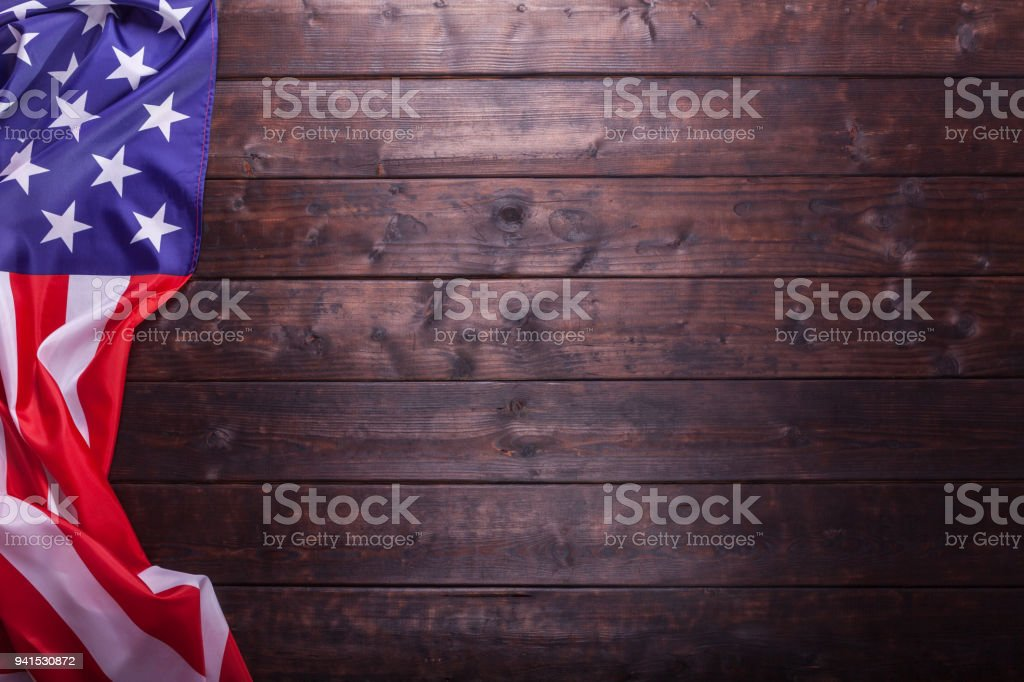 The American Flag Laying on a Wooden Background stock photo