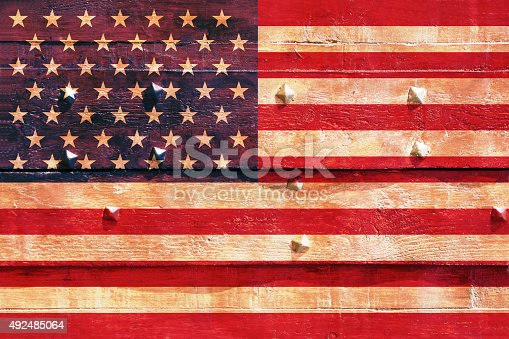 182764873istockphoto The American flag on wood plank 492485064