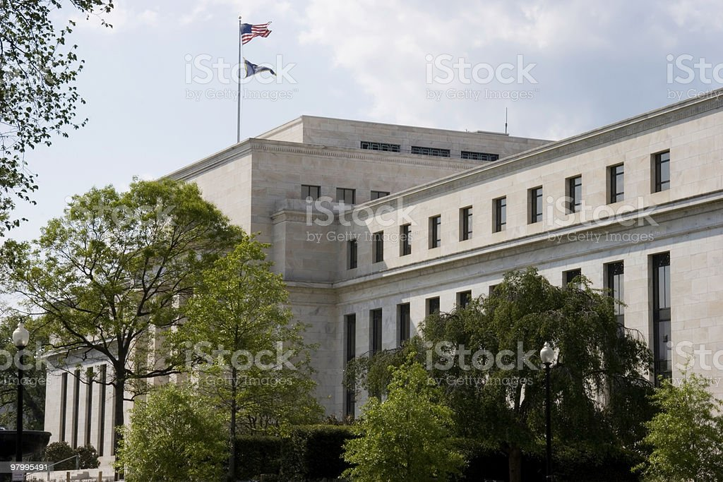 The American flag outside the Federal Reserve Building royalty-free stock photo