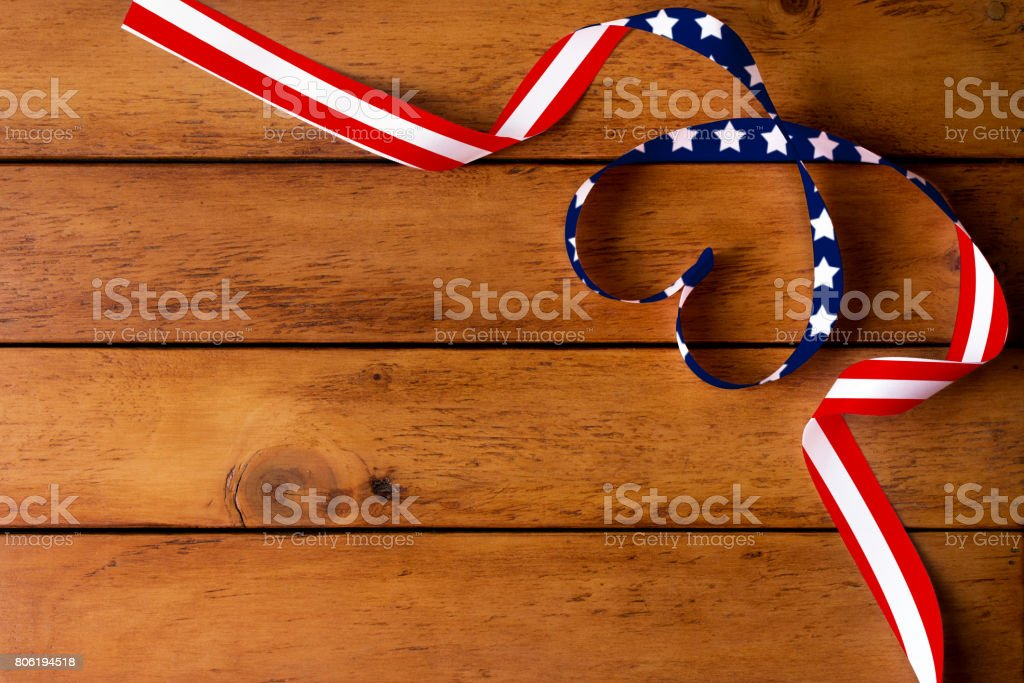 The American flag pattern and heart-shaped ribbon on wooden table/Independence Day,Memorial Day stock photo