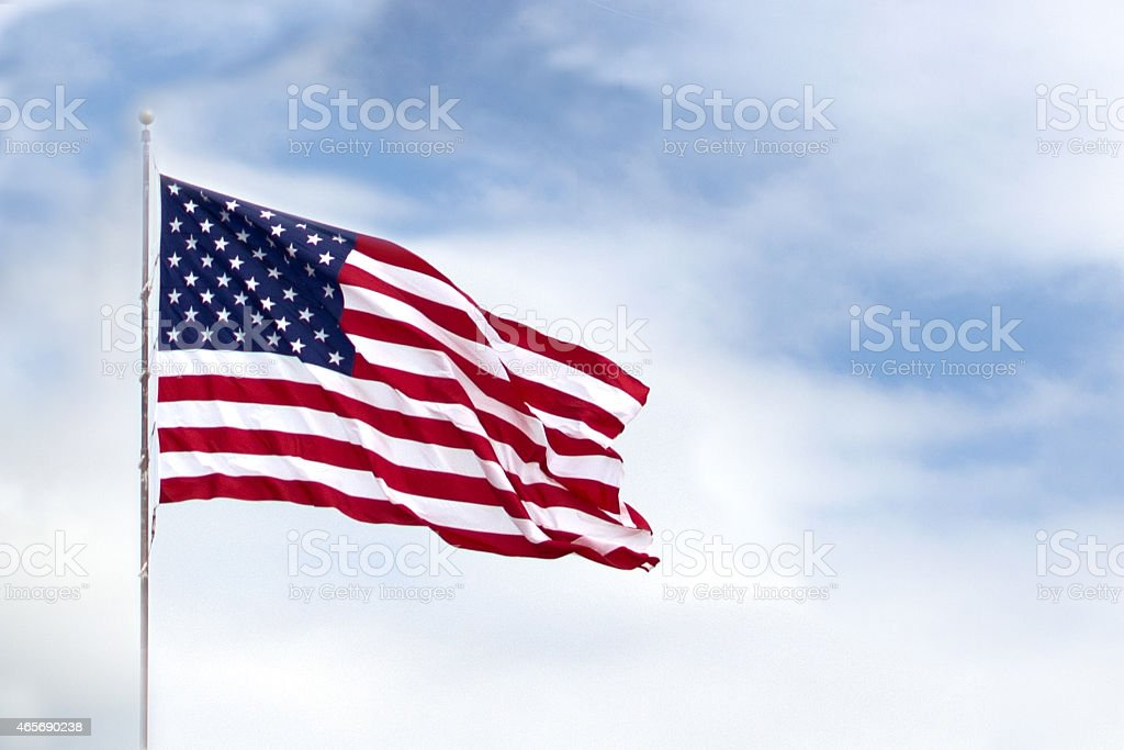 The American flag waving through the wind  stock photo