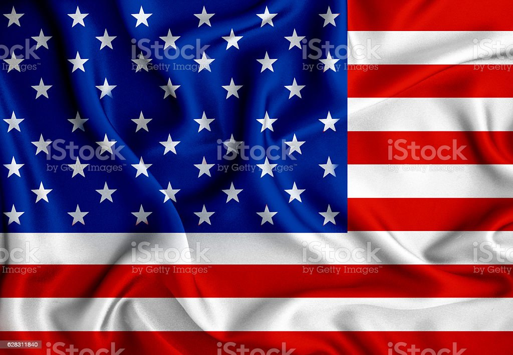 The American flag with wave  luxury silk or satin fabric stock photo