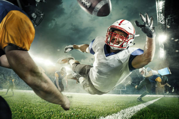 the american football players in the action - american football player stock photos and pictures