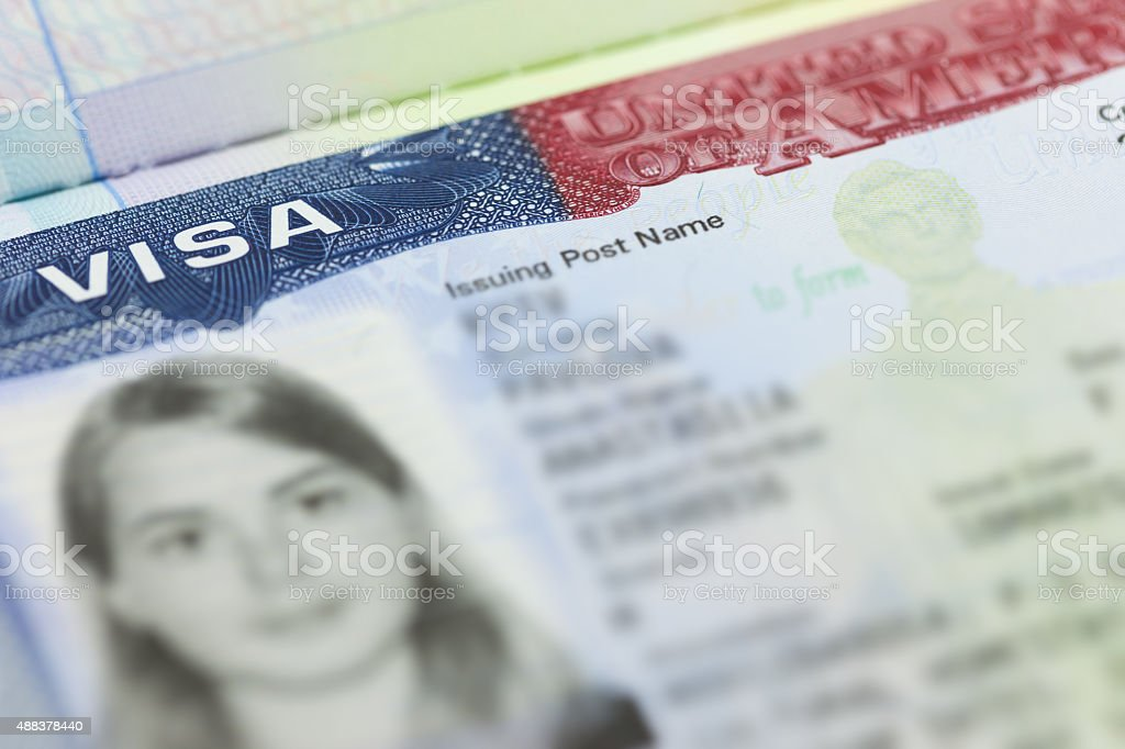 The American Visa in a passport page (USA) background stock photo