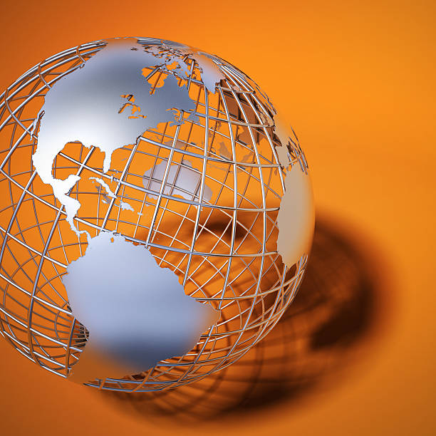 The Americas being shown on metal globe against orange stock photo