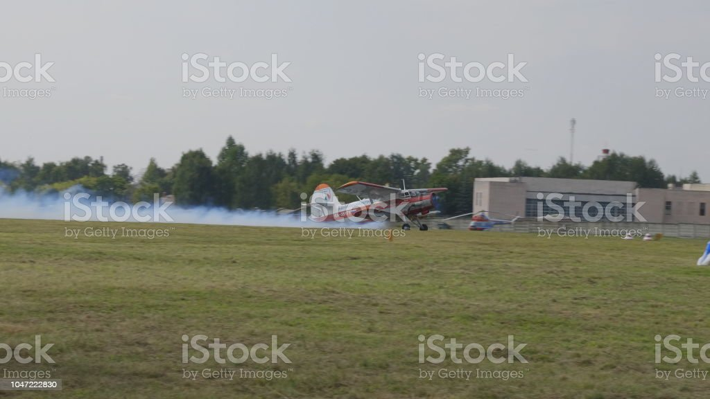 MOSCOW - SEP 2: The An-2 aircraft takes off at a celebration in honor of the 70th anniversary of the release of the first aircraft on September 2, 2017 in Moscow, Russia stock photo