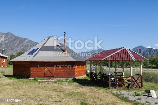 istock The ancient antique ail house from wood is round-shaped with a chimney on top of the center, for the nomadic indigenous people in the Altai Mountains with green trees and picturesque scenery. 1162074844