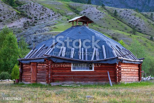 istock The ancient antique ail house from wood is round-shaped with a chimney on top of the center, for the nomadic indigenous people in the Altai Mountains with green trees and picturesque scenery. 1162075803